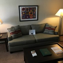 Living room with couch and tables - Kent's Best Apartments