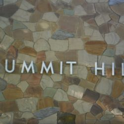 Summit Hill apartment sign on building wall - Kent's Best Apartments