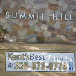 Summit Hill apartment sign and banner on building wall - Kent's Best Apartments