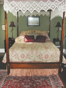 decorative queen-size four-poster canopy bed