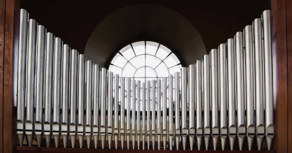 An image of pipe organ pipes.