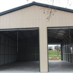 Enclosed Metal Garage with Three Rolling Garage Doors