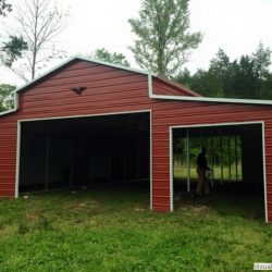 Metal Horse Barn With Gabled Ends and Framed Doorways