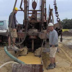 Image of workers at a drilling well