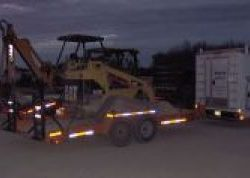 Image of CAT machine on trailer bed in the early morning