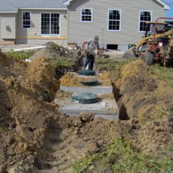 Image of stone moving from the previous pile to the trench