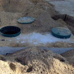 Image of septic tank partly buried