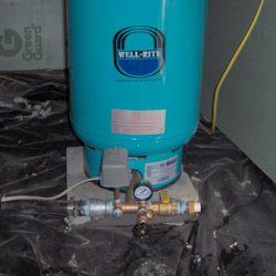 Image of well pump among water