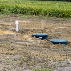 Image of backfill covering completed septic tanks