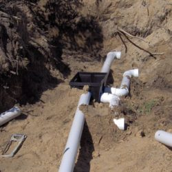 Image of pipe laying and D box installation