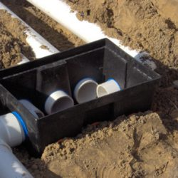 Image of plastic D box installed in dirt