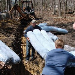 Workers carrying insulation materials