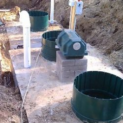 Image of septic system components lined up
