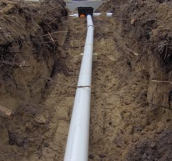 Image of large PVC piping along trenchline