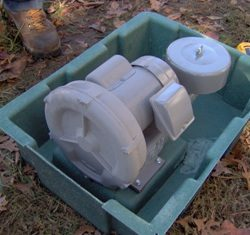 Angled view inside septic tank box