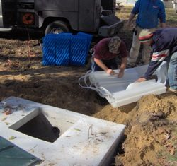 Image of employee tinkering wit septic parts