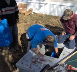 Image of employees continuing septic installation
