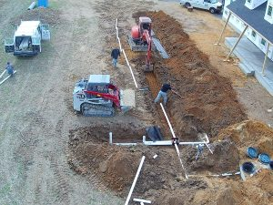 Hard at work installing a septic system