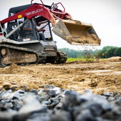 Landscape imagery of bulldozer completing gradient work