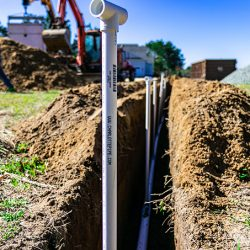 image of piping sticking out of a ditch