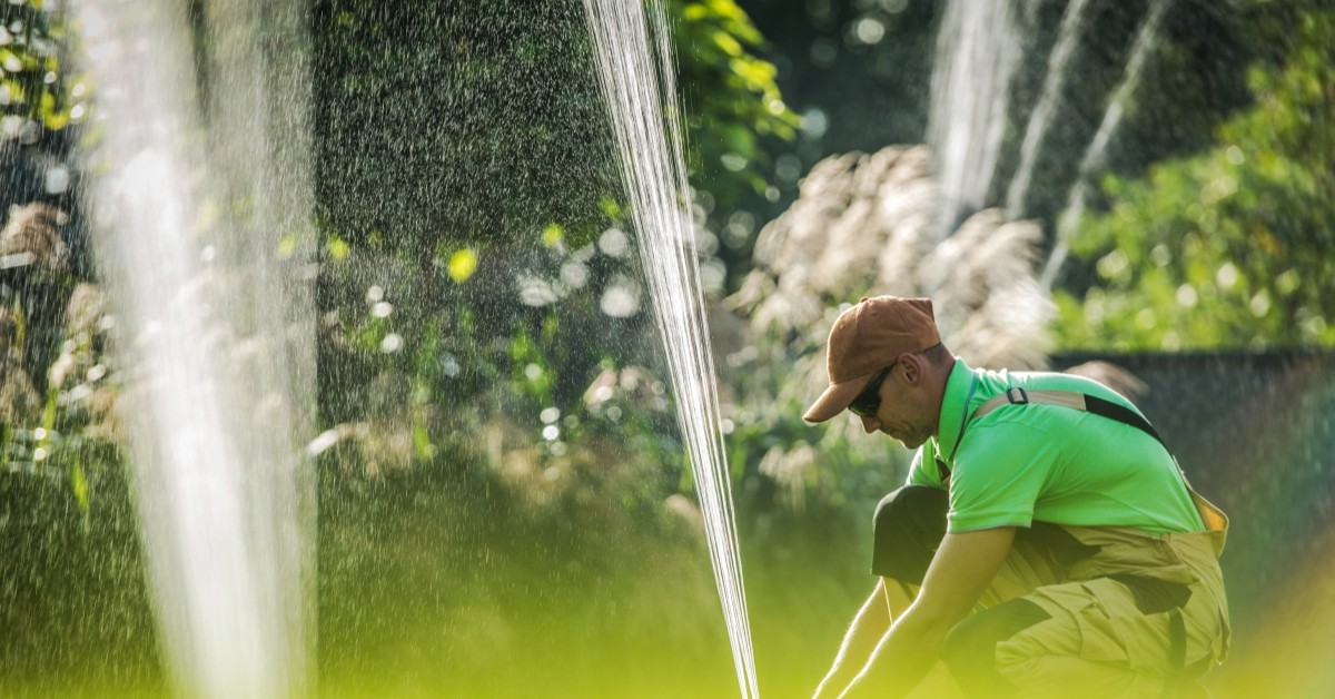 Image of Man Working On Irrigation System