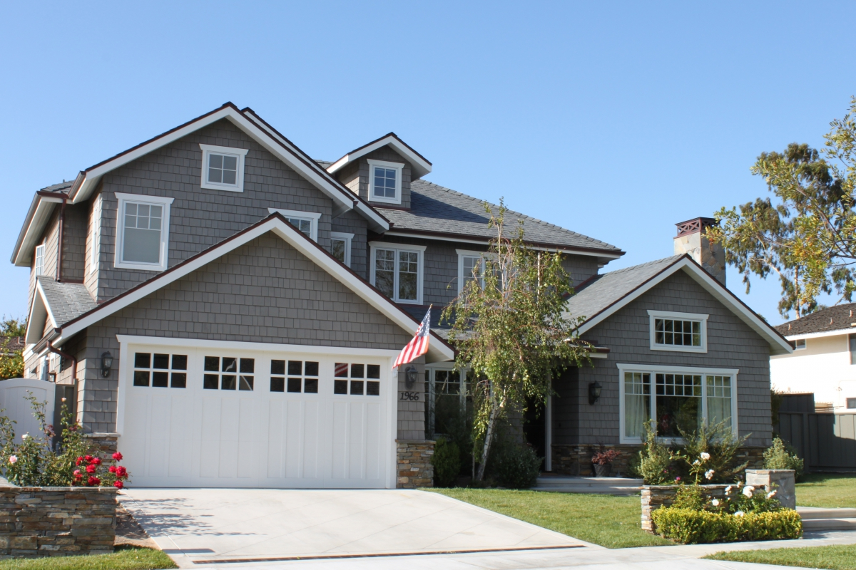 Street view of a home with an American flag in the front.