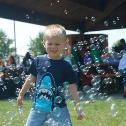 A boy playing with bubbles at our daycare - Wonder Years Learning Center