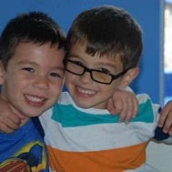 Two boys hugging at our daycare - Wonder Years Learning Center