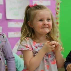 An excited girl at our child care - Wonder Years Learning Center