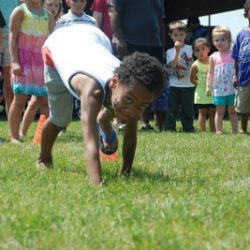 A boy doing a cartwheel at our daycare - Wonder Years Learning Center