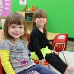Two girls smiling at the camera at our daycare - Wonder Years Learning Center