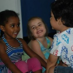 Three children talking at our daycare - Wonder Years Learning Center