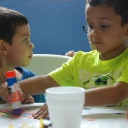 two children with arts and crafts at our child care - Wonder Years Learning Center