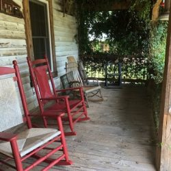 Image of Several Chairs on Old Porch