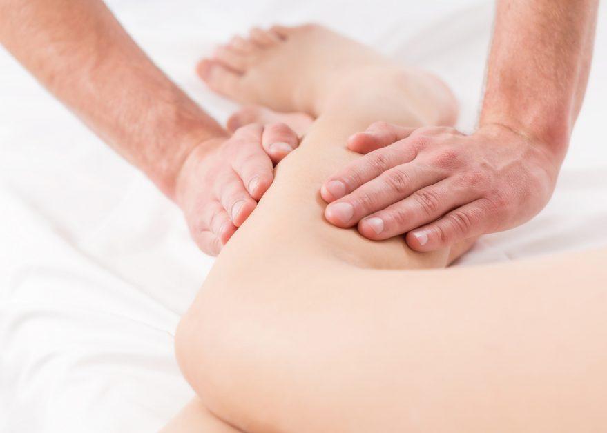 hands massaging calf muscle near the knee