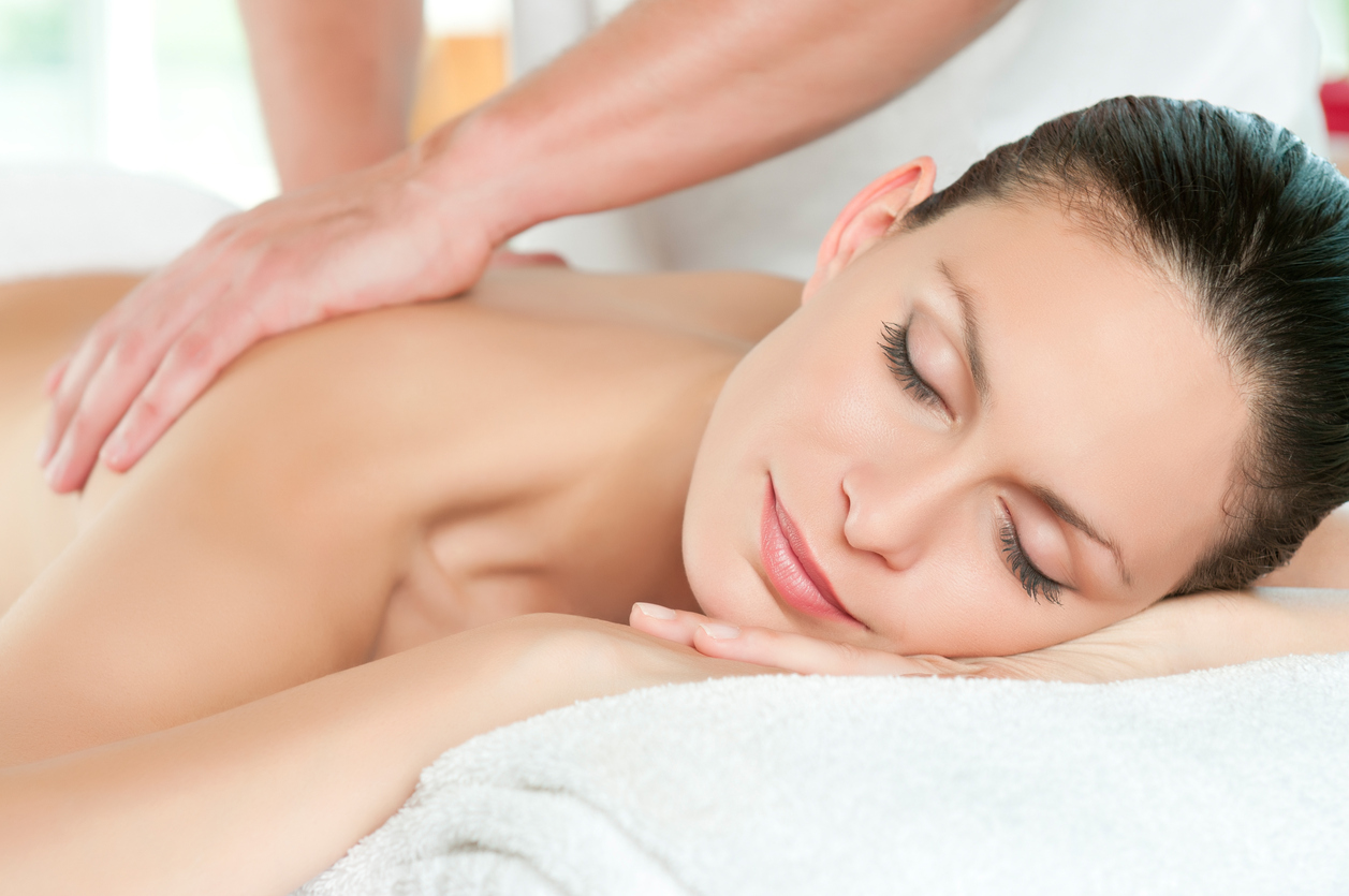 beautiful woman receiving relaxing massage at spa