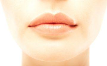 Closeup macro of sexy lips of beautiful woman over white background