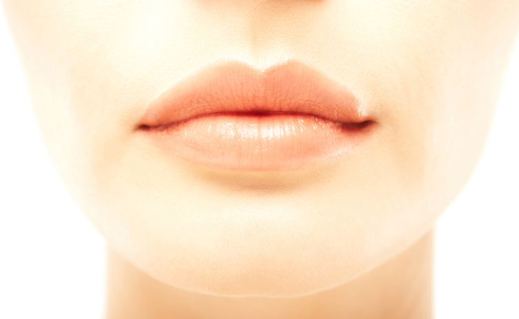 Closeup macro of sexy lips of beautiful woman over white background