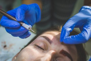Eyebrows treatment. Japanese microblading in beauty salon. Women beauty.