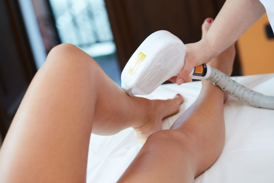 Beautician Removing Hair Of Young Woman with laser - laser hair removal