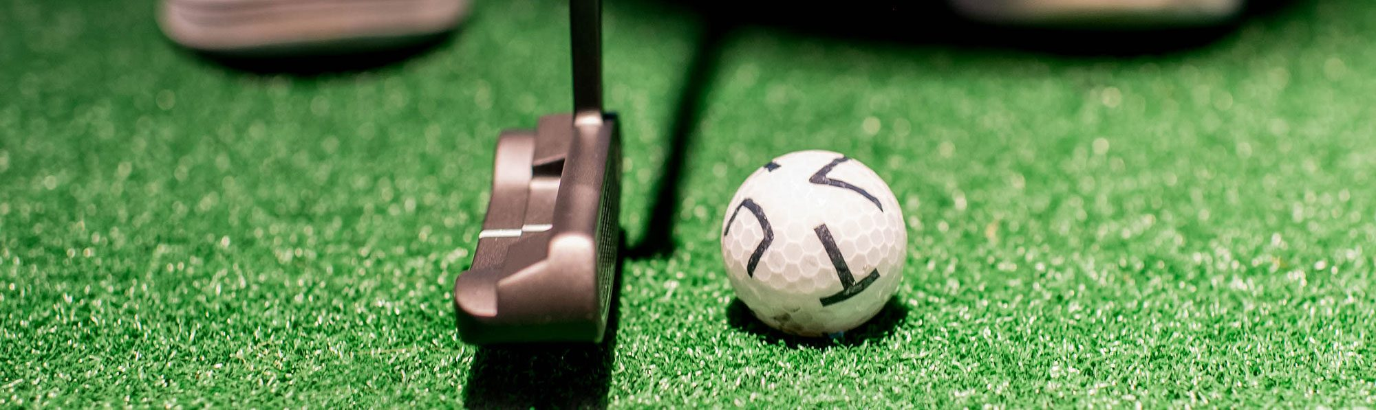Image of putter lined up with X-Golf ball