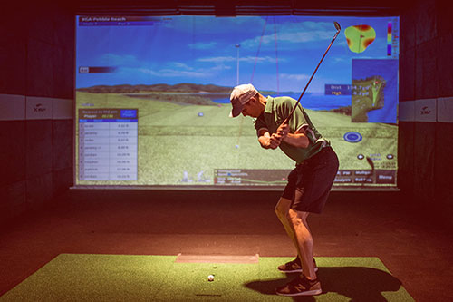 Image of lefty golfer playing at X-Golf