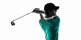 Image of golfer after follow through with green shirt on