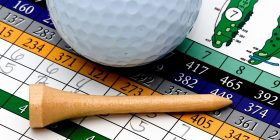 Image of golf ball and tee on scorecard