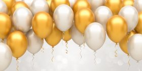 Image of silver and gold balloons floating
