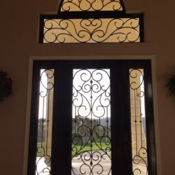 View outside through decorative glass doors with iron - Your Door Our Glass