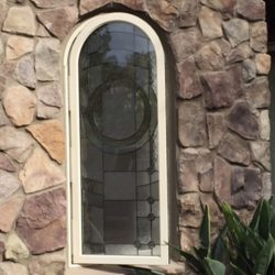 Glass door design within a stone wall - Your Door Our Glass