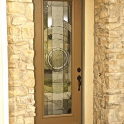 A decorative glass door with circular design - Your Door Our Glass
