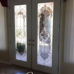 Two white doors with clear and frosted glass designs - Your Door Our Glass