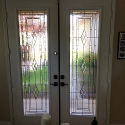 Interior entrance with Huntington glass double doors